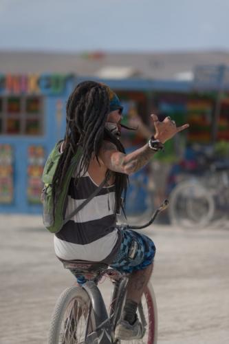 Free-spirit-riding-a-bike-at-Burning-Man-Carnival-of-Mirrors-2015-whiteout-683x1024.jpg