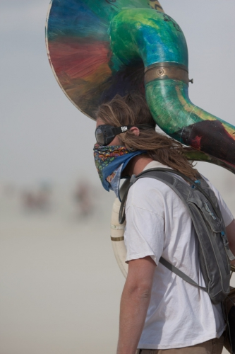 man-and-his-instrument-at-Burning-Man-2015-carnival-of-mirrors-whiteout-683x1024.jpg